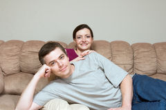 Happy, Couple Sitting on a Couch - Horizontal Royalty Free Stock Photography