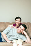 Happy, Couple Sitting on a Couch - Vertical Royalty Free Stock Photography