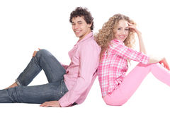 Happy couple sitting on the floor Royalty Free Stock Photos