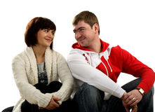 Happy couple sitting and looking at each other Royalty Free Stock Photography