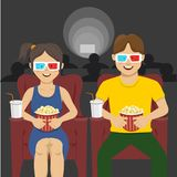 Happy couple sitting in movie theater, watching 3D movie, eating popcorn, smiling. Happy couple sitting in movie theater, watching 3D movie, eating popcorn and Royalty Free Stock Images