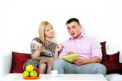 Happy couple sitting planning something Royalty Free Stock Photos