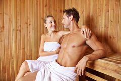 Happy couple sitting in sauna Stock Image