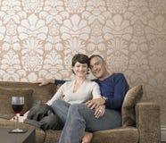 Happy Couple Sitting On Sofa stock image