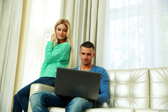 Happy couple sitting at the sofa Royalty Free Stock Photography