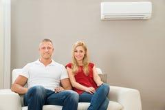 Happy Couple Sitting On Sofa Royalty Free Stock Images