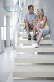 Happy Couple Sitting On Steps Royalty Free Stock Photo