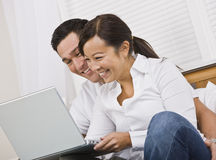 Happy Couple Sitting Together With Laptop Royalty Free Stock Photography