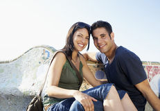 Happy Couple Sitting Together On Stone Bench Stock Photos