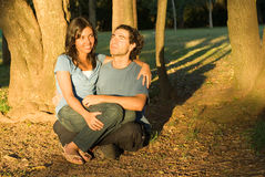 Happy Couple Sitting in the Woods. Horizontal Royalty Free Stock Photography