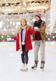 Happy couple on skating rink Royalty Free Stock Photography