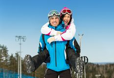 Happy couple of skiers have fun Royalty Free Stock Photography
