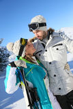 Happy couple of skiers looking at eachother Royalty Free Stock Photo