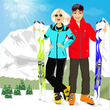 Happy couple skiers standing on edge of mountain peaks. Portrait of happy couple skiers standing on edge of mountain peaks on background of snowy mountains in Royalty Free Stock Image