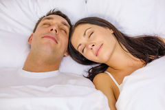 Happy couple sleeping in bed Royalty Free Stock Images