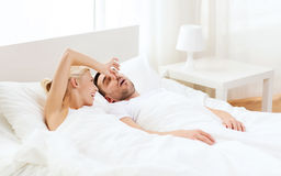 Happy couple sleeping in bed at home Stock Photos