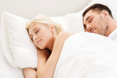 Happy couple sleeping in bed at home Royalty Free Stock Photo
