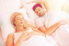 Happy couple sleeping in bed at home Stock Photo