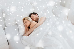 Happy couple sleeping in bed at home Royalty Free Stock Images