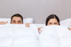 Happy couple sleeping in bed Stock Image