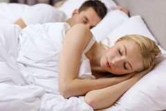 Happy couple sleeping in bed Royalty Free Stock Photos
