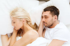 Happy couple sleeping in bed Royalty Free Stock Photography