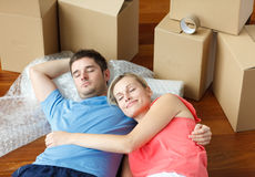 Happy couple sleeping on floor after moving house Royalty Free Stock Photos