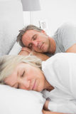 Happy couple sleeping peacefully Stock Images