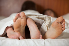 Happy couple sleeps on the bed Royalty Free Stock Photos