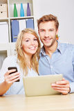 Happy couple with smartphone Stock Images