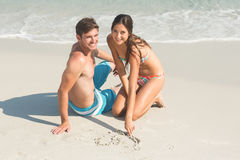 Happy couple smiling. At the beach Royalty Free Stock Photos