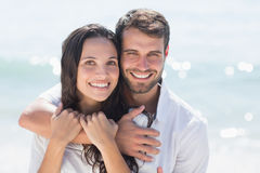 Happy couple smiling. At the beach royalty free stock images