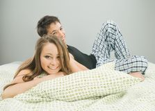 Happy couple smiling in bed Royalty Free Stock Photo