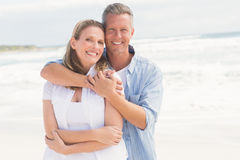 Happy couple smiling at camera. At the beach Stock Images