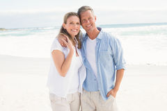 Happy couple smiling at camera Royalty Free Stock Image