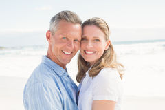 Happy couple smiling at camera. At the beach Stock Photography