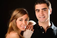Happy couple smiling at camera on black background Stock Photography