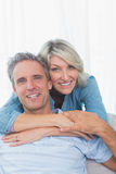 Happy couple smiling at the camera royalty free stock images