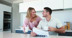 Happy couple smiling at the camera in the morning Royalty Free Stock Images