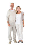 Happy couple smiling at camera together stock image