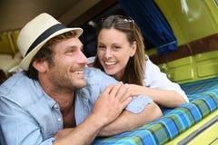 Happy couple smiling in camper van Stock Photo