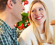 Happy couple smiling at christmas eve Royalty Free Stock Photo