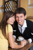 Happy couple smiling on coffee table. They young and happy. Happy couple smiling on coffee table Stock Photo