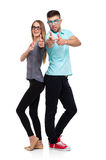 Happy couple smiling holding thumb up gesture, beautiful young m Royalty Free Stock Images