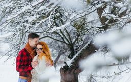 Happy Couple Smiling Hugging Holding Hands Sensitive Portrait Winter Snowfall Snow Beautiful Love Forest. Royalty Free Stock Photo