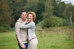 Happy couple smiling and hugging outdoors Royalty Free Stock Image