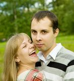 Happy couple smiling outdoors Stock Image