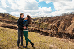 Happy couple smiling outdoors in the mountains Stock Images