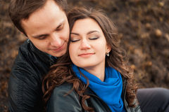 Happy couple smiling outdoors in the mountains Stock Photography