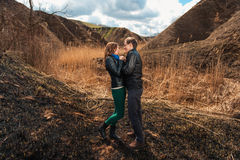 Happy couple smiling outdoors in the mountains Stock Photo